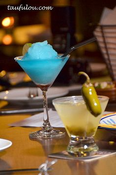 1) Blue Mountain:1 1/2oz anejo rum,  1/2oz Tia Maria® liqueur, 1/2 oz vodka, 1 oz orange juice, 1 tsp lemon jc In a shaker 1/2 filled w/ice cubes, combine  ingredients. Shake well. Strain into glass filled w/ice cubes. CHEERS!  2) Jalapeno Margaritas: Pulse 1 thin slice jalapeno, a handful of celery leaves, 6oz fresh lime juice & a spoonful of sugar in blender. Mix with 16oz tequila & 8 oz orange liqueur in a pitcher; chill. Serve on the rocks in salt-rimmed glass. CHEERS!