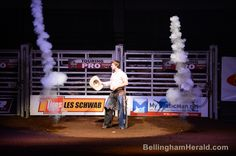 Pyrotechnics go off as bull rider Skeeter Kingsolver is introduced at the first Professional Bull Riders Touring Pro Division held at the Northwest Washington Fairgrounds on Friday, April 2013 in Lynden. ANDY BRONSON — THE BELLINGHAM HERALD