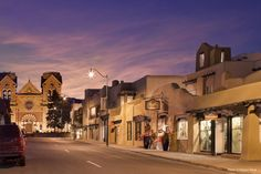 San Francisco Street with La Fonda Hotel and the Basilica of St. Francis. Santa…