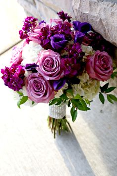 Flowers by Sisters Floral Design www.sistersflowers.net  Image by Woven Bone Photography.  Lavender, dark purple, bridal bouquet, lavender roses, purple lisianthus