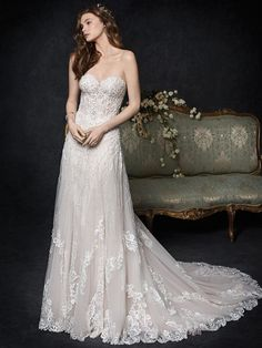 Bead and lace encrusted a-line bridal gown with semi-sheer bodice and basque waist available off-the-rack at Silk Bridal Studio. Wedding Dress Styles, Designer Wedding Dresses, Bridal Gowns, Wedding Gowns, Wedding Girl, Summer Wedding, Dream Dress, Fashion Dresses, Beaded Embroidery