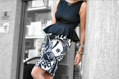 black peplum top with black and white print pencil skirt