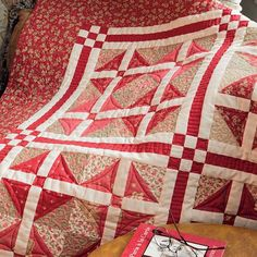 Love this red-and-white sashing - and the Parcheesi-style blocks!