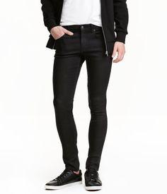 25  Black. 5-pocket, ultra-slim-fit pants in stretch denim. Regular waist, slim legs, and zip fly.