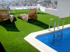 """This """"grass""""-roof villa is the perfect place to swim or just admire the panoramic views of the city below. Artificial grass courtesy of Edel Grass . Modern Landscaping, Pool Landscaping, Roofing Options, Modern Shed, Storage Shed Plans, Outdoor Sheds, Outdoor Swimming Pool, Roof Design, House Roof"""