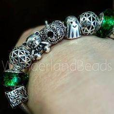 Is it Halloween yet? #wonderlandbeads #charm #charms #charmaddict #charmbracelet #pandora #pandoraaddict #Ohm #ohmbeads #ohmbeadofthemonth #beadofthemonth #ohmhugme #hugme #ohmdeadhead #deadhead #sugarskull #Redbalifrog #Chamilia #beadaddict #jewelry #jewellery #jewleryaddict #bracelet #armparty