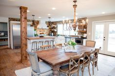 Removing several walls opened up opportunities for reimagining some key spaces. In the more open floorplan, the dining room is now contiguous with both the kitchen and living room.