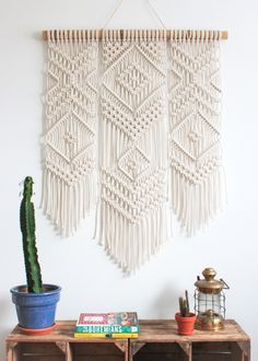 This macrame wall hanging is hand-knotted using 100% cotton cord (braided, 5mm) in natural ecru with a bamboo supporting rod. Approx Dimensions > Width: 86cm / 34 inches Length: 120cm / 47 inches