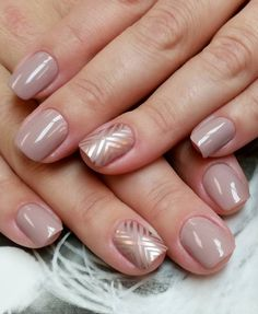 A combination of nude and platinum nail polish. In diagonal shapes, the metallic polish simply makes the nude nail polish stand out from behind.