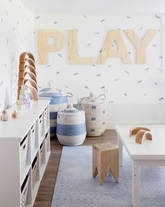 Playroom inspiration! Modern playroom with neutral palette and pops of subtle blue. Airy. spacious, and cute storage options.