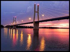 The Bayview Bridge over the Mississippi River, Quincy, Illinois, photo by Tiger Imagery. We lived in Quincy for about five months in 1989-90. Memories of this bridge include driving across it to the Missouri side to gas up the van, because gas cost 50 cents less per gallon than in Illinois!