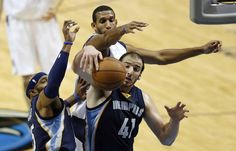 Memphis Grizzlies guard Vince Carter (15), Memphis Grizzlies center Kosta Koufos (41) and Dallas Mavericks forward Brandan Wright (34) go up for a rebound during the first half of play in a preseason game at American Airlines Center in Dallas on Monday, October 20, 2014. (Vernon Bryant/The Dallas Morning News)