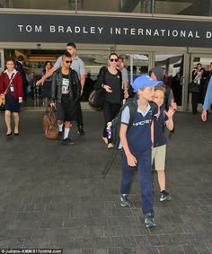 On their way out: Pax, 11, Shiloh, 8, and Knox, 6, stayed close to one another as they kep...