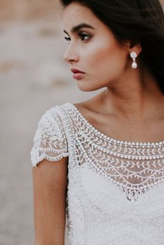 ivory hand-beaded dress with boat neckline and capped sleeves