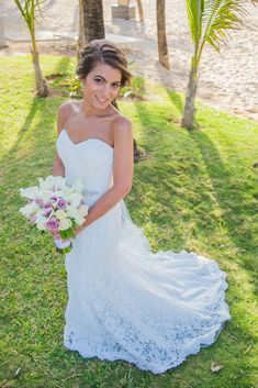 For her Real Wedding at Riu Yucatan, Ashley wore a gorgeous lace gown with a sweetheart neckline and beaded belt.   Photography: Adventure Photos