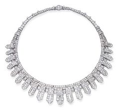 AN IMPORTANT ART DECO DIAMOND NECKLACE/'HALO' HEAD ORNAMENT, BY CARTIER  Designed as graduated pavé-set diamond pierced panels with baguette-cut diamond spacers to the circular-cut diamond line and backchain, with fitting to convert to head ornament, circa 1935