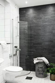 Best feather wall bathroom for my budget white wall tiles very inexpensive,allows me to splash on the awesome dark grey wall..
