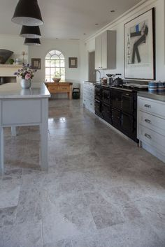 Create a modern living style with grey & white hues of Tundra Tumbled Marble wall & floor tiles at Mandarin Stone. Stone Tile Flooring, Foyer Flooring, Natural Stone Flooring, Stone Tiles, Kitchen Flooring, Flooring Types, Slate Flooring, Kitchen Chairs, Flooring Ideas