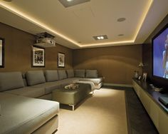 , Modern Entertainment Room Ideas For Home Theater Also Modern Gray Couch Also Olive Coffee Table Color Also Elegant Ceiling Design With Ceiling Hidden Lights Also Beige Carpet Color Also Modern Wall Mount Table: Entertainment Room Ideas for Your Home