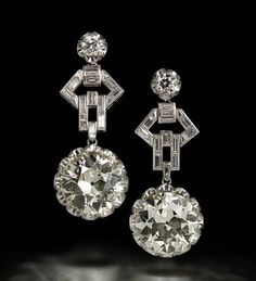 An impressive pair of diamond pendent earrings, circa 1960