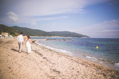 Bride and groom walking on the beach at their Domaine de la Croix Hotel L