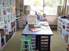 shelving-check. island workspace-check. natural lighting-check. mini drapes-check. cute little stool-check.  PERFECTION!