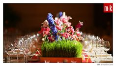 Plant boxes instead of vases for table setting.