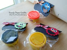 Sesame Street - play-doh favour packs.  Use Stampin' Up flower punch to make the character heads and add faces!
