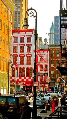SoHo is a neighborhood in Lower Manhattan, New York City, NY, USA.  It has recently been a location for many artists' lofts and art galleries, but is now more noted for its variety of shops ranging from trendy upscale boutiques to national and international chain store outlets.  Photo: indulgy.com