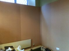 A new display wall just erected, before painting