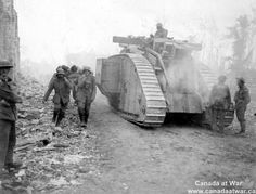 Traffic on the Amiens-Roye Road - German prisoners carry Canadian wounded to the rear, passing a tank on the Amiens-Roye road during the Battle of Amiens. The Allies used 420 tanks during the surprise attack on 8 August 1918, but the majority had been knocked out or broke down by the end of the battle.