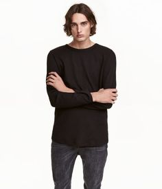 Long-sleeved T-shirt in waffle-knit jersey with a seam at center back and a  rounded hem.