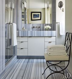 Striped marble sheathes the master bath of designer David Kleinberg's Manhattan apartment; the chair is by Jean-Charles Moreux, and the towels are by Waterworks. Architectural Digest, Bad Inspiration, Bathroom Inspiration, Bathroom Ideas, Bathroom Designs, Bathroom Design Luxury, Bathroom Interior, Grey Bathrooms, Beautiful Bathrooms