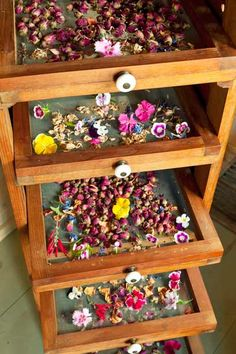 Custom screen racks dry rosebuds, lavender, violas, red salvia, and pinks, including a lavender and rose-petal mix this avid gardener uses for tea and a confectioner's sprinkle of Viola tricolor for ice cream. | Photo: Mark Lohman | thisoldhouse.com