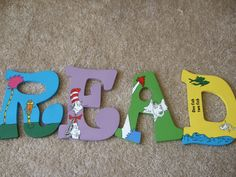 Items similar to Hand-Painted Dr. Seuss Wooden Letter for Nursery or Child's Room - Beautiful Christmas or Baby Shower Gifts on Etsy Hand-Painted Dr. Wooden Letters For Nursery, Painting Wooden Letters, Painted Letters, Classroom Crafts, Classroom Themes, Lorax, Toy Room Storage, Skinny Quilts, Quilted Table Runners
