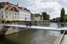 Arhitektura d.o.o. has designed a footbridge in Ljubljana to be as minimal and transparent as possible.