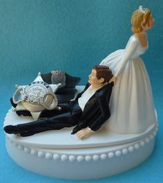 this one is funny:)) Wedding Cake Topper Police Officer Policeman Groom Themed w/ Garter & Display Box. $59.99, via Etsy.
