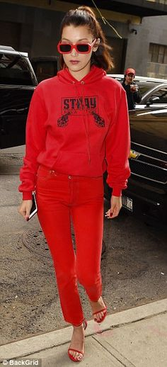 Monochromatic: Bella chose to wear all-red with a pair of bright high-waisted skinny jeans...