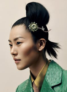"""""""My favorite gem is jade,"""" says the model Liu Wen. """"It can help its wearer evade bad luck."""" Prada crystal hair clip, ostrich coat, mohair sweater ($590), and silk shirt ($830); select Prada boutiques."""