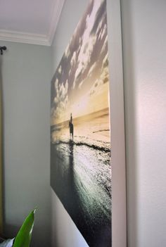 Mounting a picture on a canvas DIY and way cheaper than paying someone else to do it!