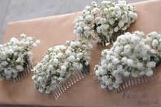 Wedding of the Week: Victoria Cook and Ian Bissell | The bride and groom for this wedding had flower arrangements made up of an array of white and green that included their favourite flower, lisianthus, as well as other fresh flowers.