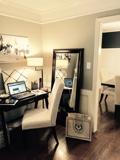 Home office area in formal living room. Sophisticated yet practical use of space.