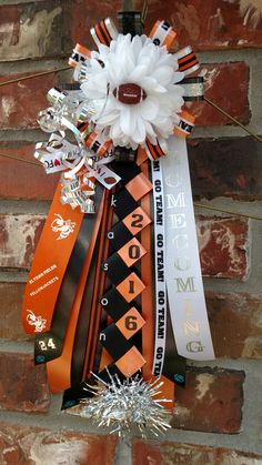 "Mini boys garter mum. 12"" streamers and 4"" flower. Orange black and white homecoming mum. Designed by Crafty bug"