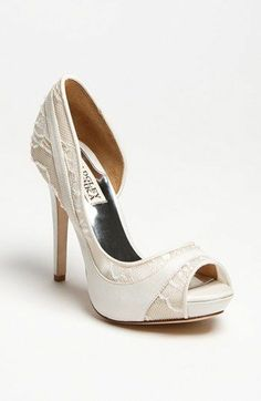 """Badgley Mischka - 'Nora' Pump  Barely there beads dust a lacy silk pump with ethereal shimmer. 4"""" heel; 1/2"""" platform. Silk and lace upper/leather and mesh lining/leather sole."""