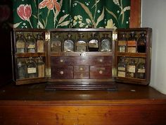 """Historical note:  In the early part of the 1800's, there were no drug stores and a household would typically have to administer medications which were available to the servants or other members of the family.  The mahogany case above would be typical of one used in a household of obviously well-to-do people.  In the colonies, these medical cases were used on the """"plantations"""" and contained all sorts of plant extracts and chemicals of dubious use."""