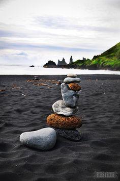 Balancing rocks on a black sand beach in Iceland - Love Iceland!