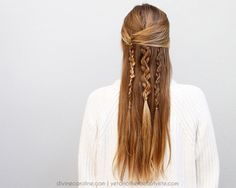These layered boho braids give your half updo a unique twist. #braid #updo #boho