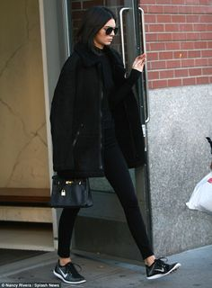 Monochromatic: Kendall Jenner looked chic in an all-black ensemble as she stepped out solo for her Victoria's Secret Fashion Show fitting in New York City on Sunday ahead of her debut