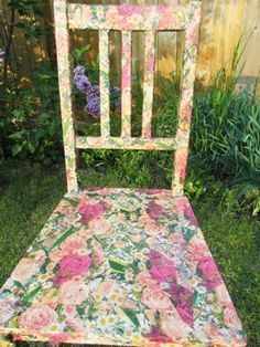 Mod Podged Chair using patterned napkins or tissue paper.  I don't think I'd want flowers.  Maybe polka dots?  That would be cute in the kids' room.