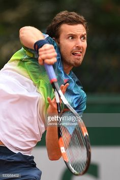 Ernests Gulbis of Latvia serves during the Men's Singles first round match against Andreas Seppi of Italy on day three of the 2016 French Open at Roland Garros on May 2016 in Paris, France. Get premium, high resolution news photos at Getty Images French Open, First Round, The Man, Men, Image, Guys